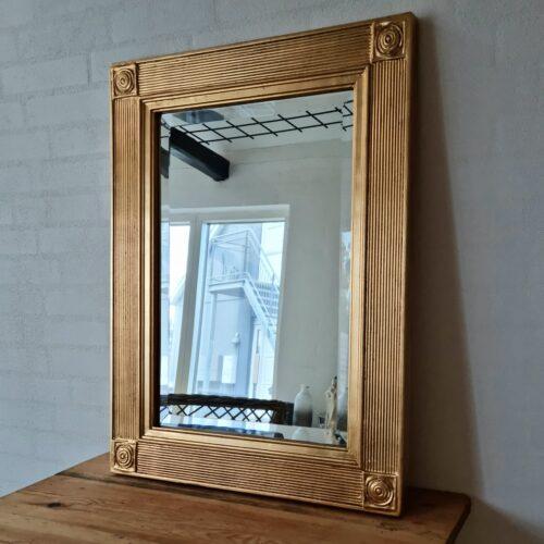 Facetslebet guldspejl